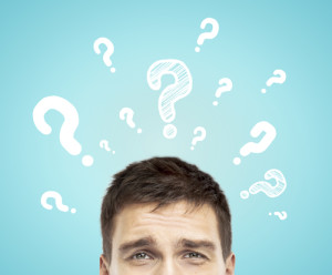 Top half of a man's head with question mark above his head on a blue background